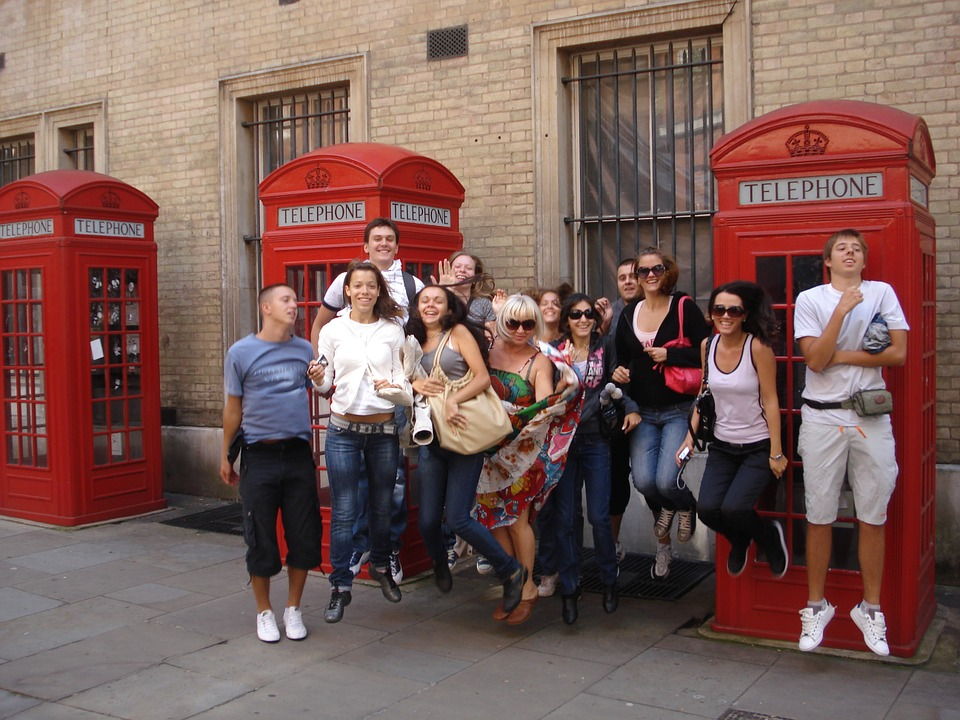 students in London in front of a telephone booth